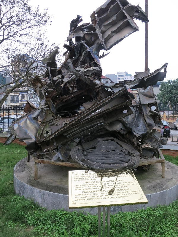 Plaque reads: Carcasses of various US tactical Jets shot down by the army and the people of the Tal in the fight against the US war on Hanoi capitol.