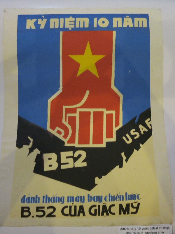 "Translation at bottom reads: ""Anniversary 10 years defeat strategic B52 plane of American army"""