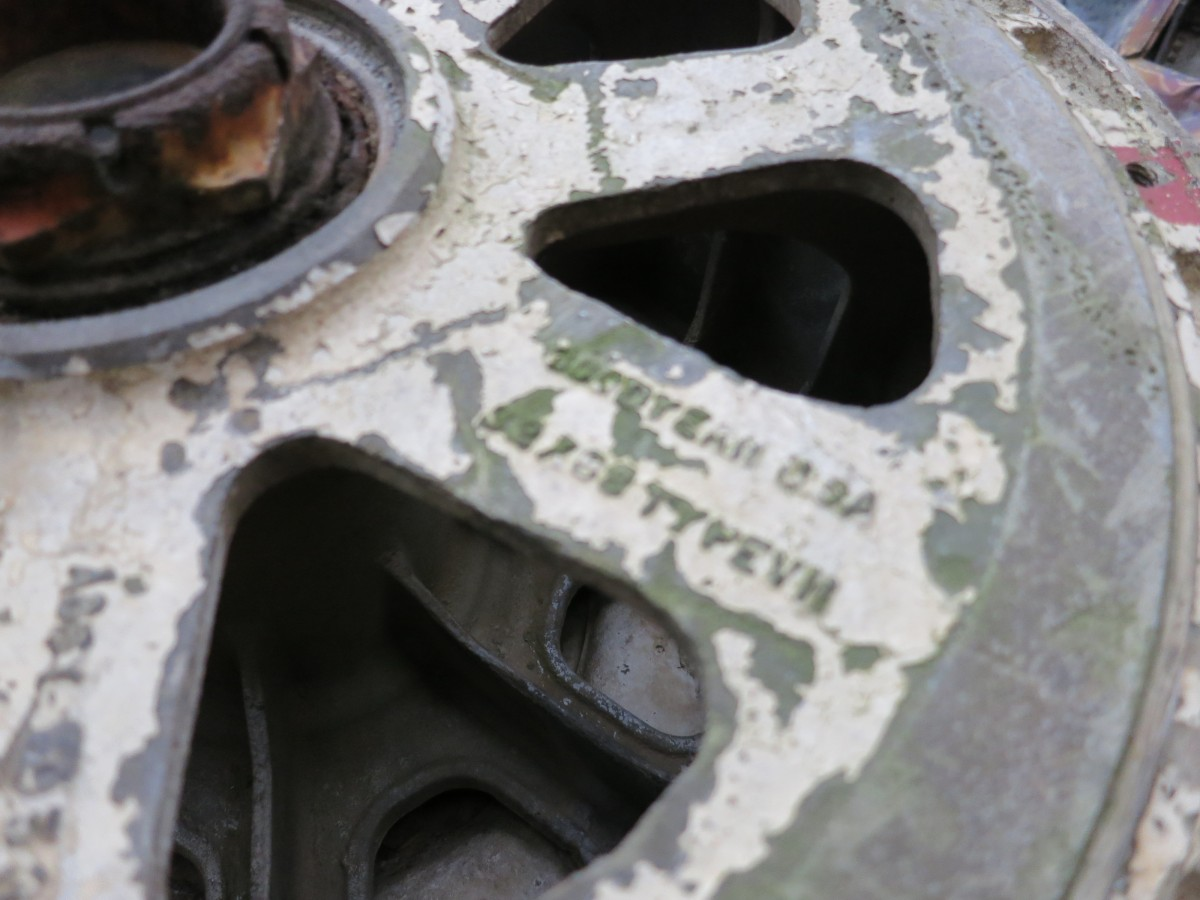 "A wheel from a fighter jet in the ""carcasses"" of shot down jets. Notice that the inscription on the wheel says, ""Goodyear USA"""