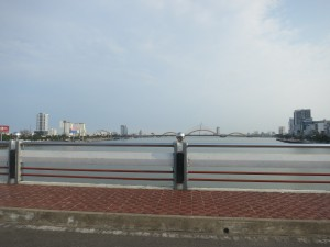 Driving across one of the many bridges in Danang, looking south. Notice the dragon bridge in the distance.