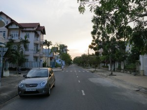 A typical street in Danang. Looking west, our hotel was up on the right. Behind us is the beach.