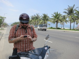 Da Nang highway next to the beach. Heading south toward the Marble Mountains on Yamaha scooters.