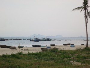 Fishing boats in Da Nang. In the background are the Marble Mountains.