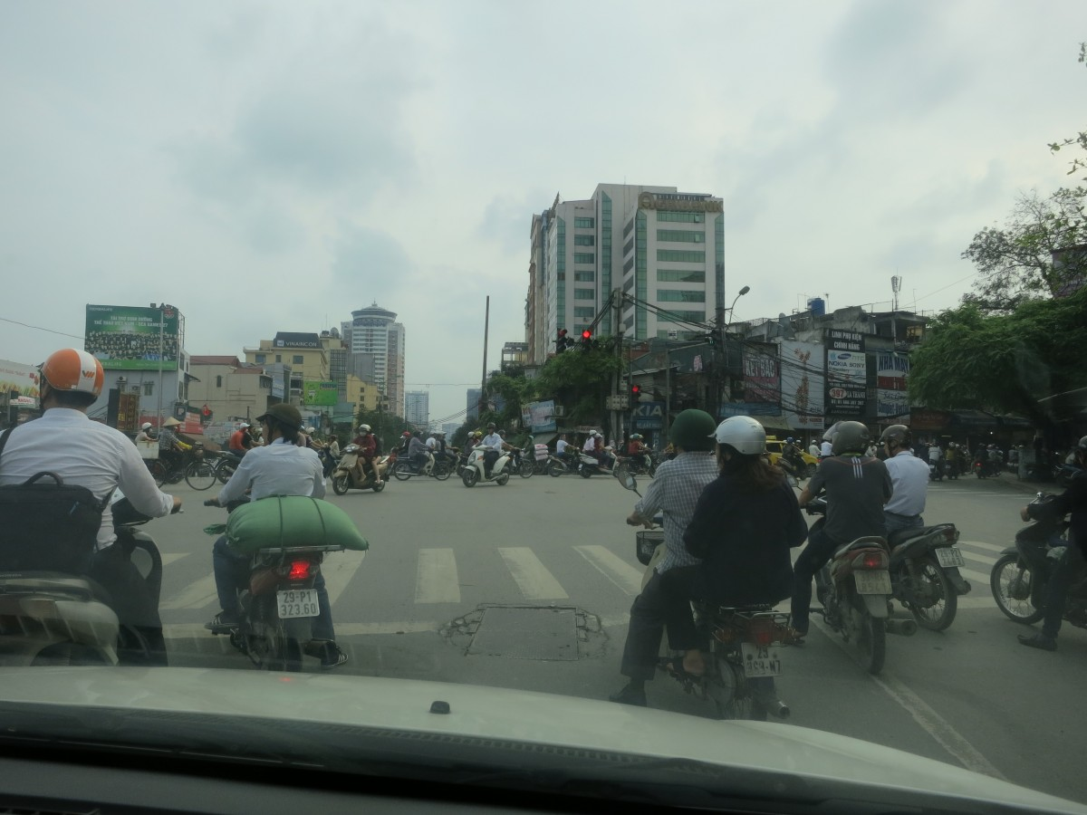Back in Hanoi watching traffic.
